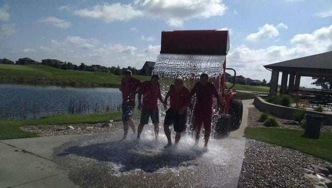 Tom Walsh and others from GreatLife take the Bucket Challenge.