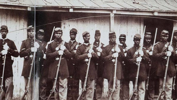 The men in this undated photo may or may not be members of the 2nd U.S. Colored Infantry, but this image was used as a source for the mural on the federal courthouse in Fort Myers..