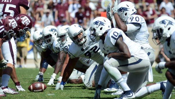 The Wolf Pack's defensive line, shown during a game at Texas A&M last season, will have a completely new look in 2016.