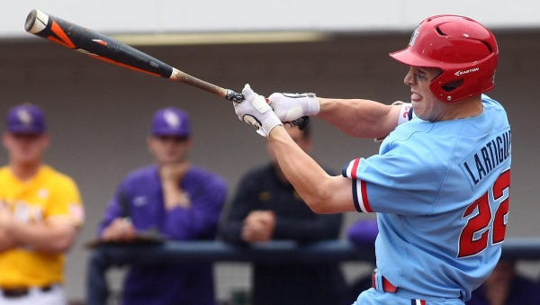 Catcher Henri Lartigue swings at a pitch during Ole Miss' series last weekend against LSU. The junior took major steps forward at the plate and entered this weekend's series against Georgia hitting .340.
