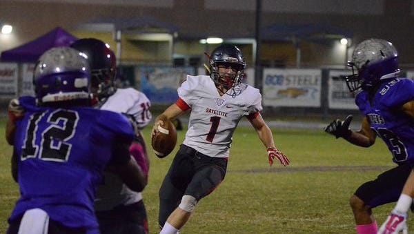Scorpion quarterback Alex Nicks finds an open hole for yardage Friday night as they visited the Vipers. (photo by Tony Dees/Florida Today)