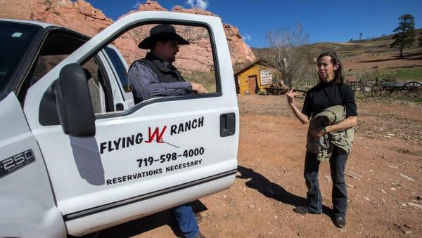 Flying W Ranch owner Leigh Ann Wolfe talks things over with general manager Aaron Winter Friday, May 5, 2017, at the Flying W Ranch in Colorado Springs, Colo. Most of the tourist venue was burned to the ground in the 2012 Waldo Canyon Fire and Wolfe has been fighting to bring it back since. (Christian Murdock /The Gazette via AP)