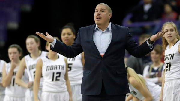 Appleton North High School's coach Joe Russom disagrees with a call as they play  against Arrowhead High School during their Division 1 semifinal game at the WIAA state girls basketball tournament Friday, March 9, 2018, at the Resch Center in Ashwaubenon, Wis.
