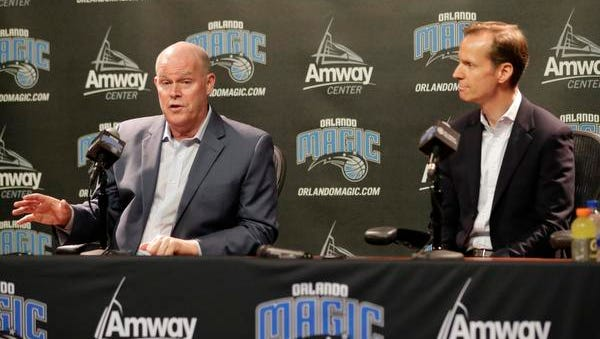Orlando Magic President of Basketball Operations Jeff Weltman, right, listens as the teams new head coach Steve Clifford answers questions at an NBA basketball news conference Wednesday, May 30, 2018, in Orlando, Fla. (AP Photo/John Raoux)