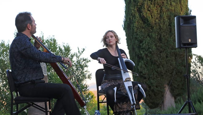 Daniel Gaisford and Jessika Soli of the cello duo Rosin perform May 12 at the DiFiore Center in St. George.