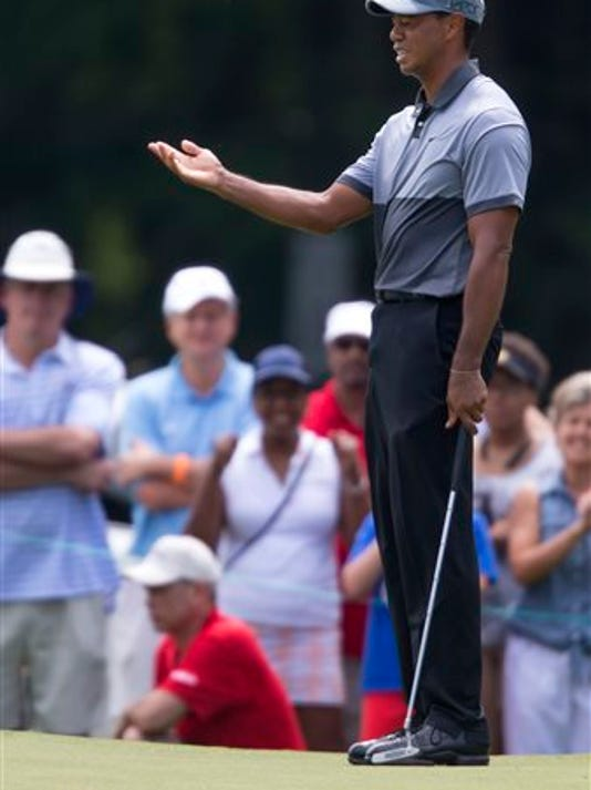Tiger Woods reacts after missing a putt on the fourth hole during the third round of the Wyndham Championship golf tournament at Sedgefield Country Club in Greensboro, North Carolina, on Saturday.