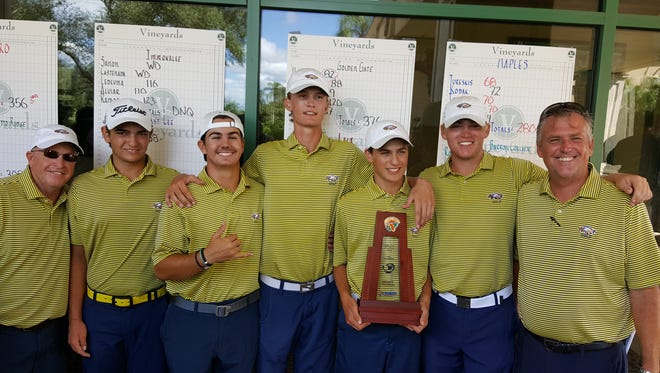 The Naples High School boys golf team poses with the Class 2A-District 21 championship trophy. The Golden Eagles won the team title at the Vineyards Country Club on Monday.