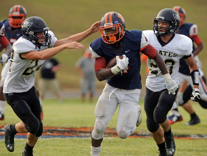 Escambia Gator Terik Miller runs down field with Vidor (Texas) Pirates Justin Kaiser (24) and Jacob Ernst (20) on his tail Saturday at Escambia High School.