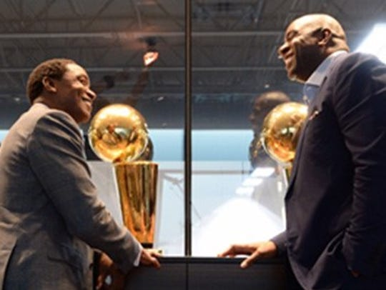 Isiah Thomas, left, and Magic Johnson share stories