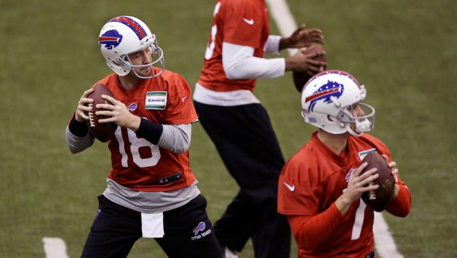 Buffalo Bills quarterbacks Kyle Orton (18), Jeff Tuel, foreground, and EJ Manuel, rear, run through drills at the Detroit Lions' training facility on Friday in Allen Park, Mich.