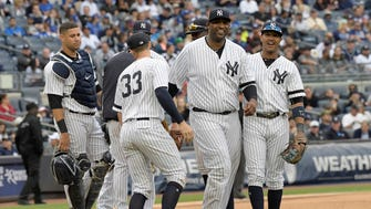 New York Yankees pitcher CC Sabathia smiles as he leaves the baseball game as Starlin Castro, right, looks on during the sixth inning of a baseball game against the Toronto Blue Jays, Saturday, Sept.30, 2017, at Yankee Stadium in New York.