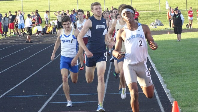 Granville senior Jonny Lukins places second in the 800 behind Hilliard Darby freshman Malachi McGill this past Friday during the Division I regional meet at Pickerington North.