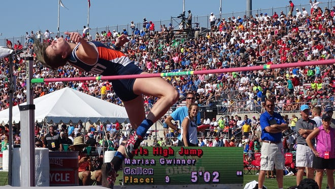 Galion's Marissa Gwinner tries to clear the bar in the high jump during the Division II state track meet Friday at Jesse Owens Memorial Stadium.