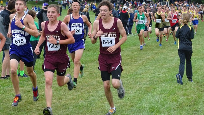 Licking Heights sophomore Garrett Miller, middle, and senior Spencer Queen compete this past Saturday in the Granville Invitational on the grounds of the Bryn Du Mansion.