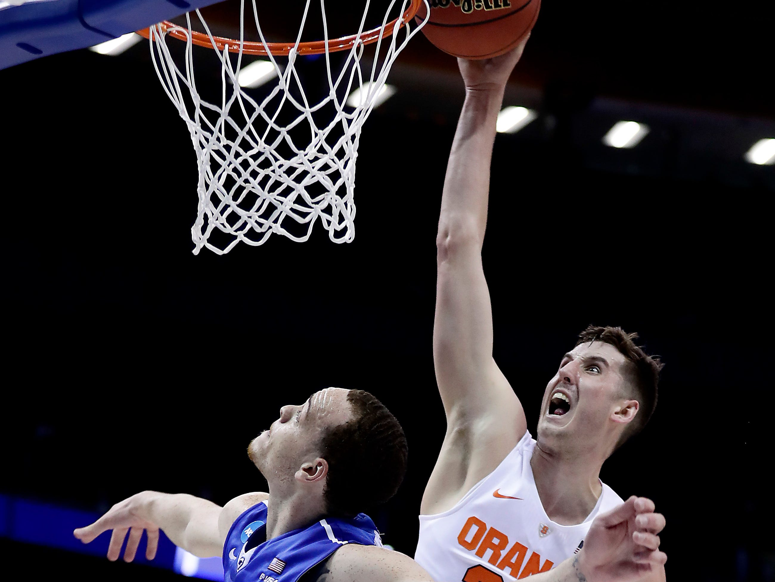 Syracuse's Tyler Lydon, an Elizaville native, dunks over the head of Middle Tennessee's Reggie Upshaw at Scottrade Center in St. Louis, Missouri Sunday.