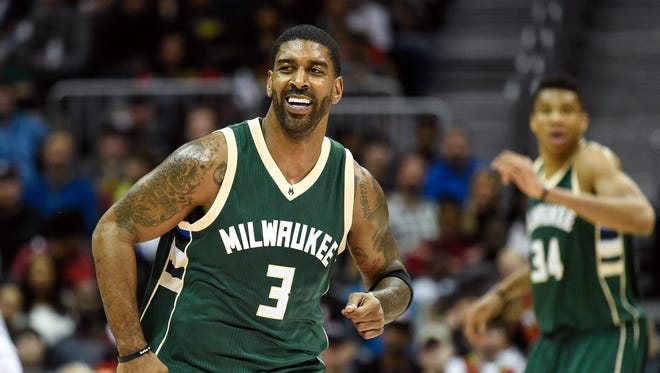 Feb 20, 2016; Atlanta, GA, USA; Milwaukee Bucks guard O.J. Mayo (3) reacts after a three point basket against the Atlanta Hawks during the second half at Philips Arena. The Bucks defeated the Hawks 117-109 in double overtime. Mandatory Credit: Dale Zanine-USA TODAY Sports