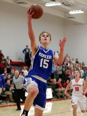 Kohler's Sean Farrell (15) drives to the basket against Oostburg on Jan. 2.
