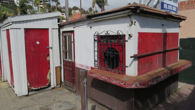 Vacant since 2010, the Top Hat burger stand in the 200 block of East Main Street in downtown Ventura is the topic of controversy as property owners seek the OK to build condominiums at the site.