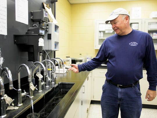 Steve Turner, a water plant operator III, discusses the various stages of filtration and treatment of water running through taps in North Fork water treatment's lab February 21, 2017.