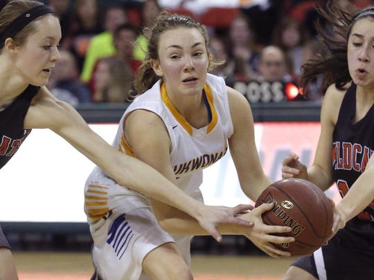 Mukwonago's Grace Beyer is converged upon by Verona's Heather Rudnicki (left) and Cheyenne Trilling in the 2016 Division 1 state championship game.