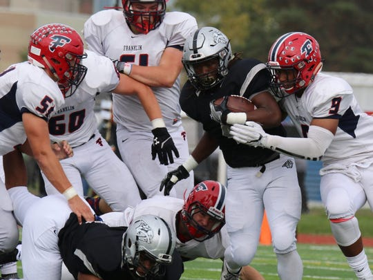Plymouth running back Darius Timmons fights for extra