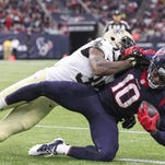 Houston Texans wide receiver DeAndre Hopkins (10) makes a reception as New Orleans Saints cornerback Brandon Browner (39) defends during the first quarter at NRG Stadium.