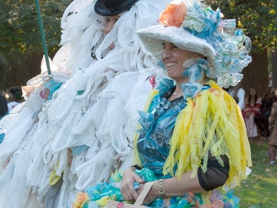 Bill Batson, left, and Maria Luisa Whittingham promote their Say No to the Bag campaign at the 2014 Halloween Parade. Whittingham's dress is made from recycled plastic bags.