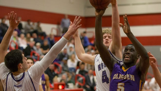 Camden's Myles Thompson goes up with shot as Rumson's Teddy Sourlis moves up to block him. Camden Boys Basketball vs Rumson-Fair Haven in NJSIAA Group II Semifinal game in Perth Amboy, NJ on March 9, 2017