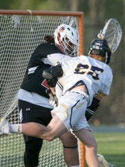 Hartland's Brandon Plemmons muscles one of his two