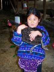 Undated photo of a young Ada Sorensen with a chicken