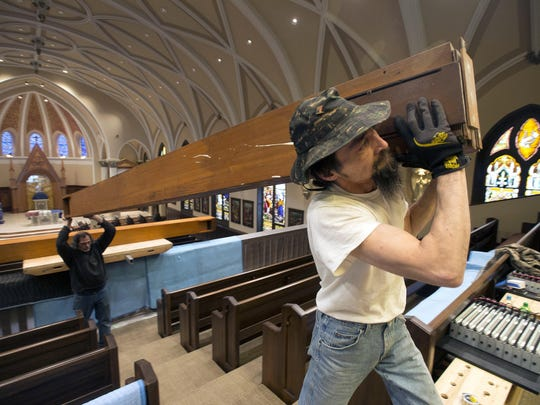 Bob Dykstra, right, and Dan Staley of Lauck Pipe Organ Co. carry a large wooden pipe. The tallest pipe on the organ is 16 feet and weighs about 200 pounds. The organ has approximately 1,800 pipes.