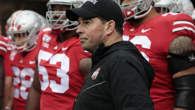 In this file photoOhio State Buckeyes head coach Ryan Day waits to take the field before a NCAA Division I college football game between the Ohio State Buckeyes and the Wisconsin Badgers on Saturday, October 26, 2019 at Ohio Stadium in Columbus, Ohio.