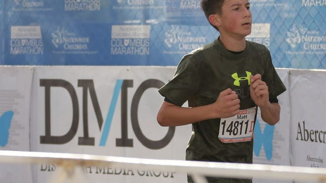 Matt Manivilovski, 13, of Delaware finishes the Nationwide Children's Hospital Columbus 1/2 Marathon in 2019. The event has been canceled this year because of the COVID-19 coronavirus pandemic.