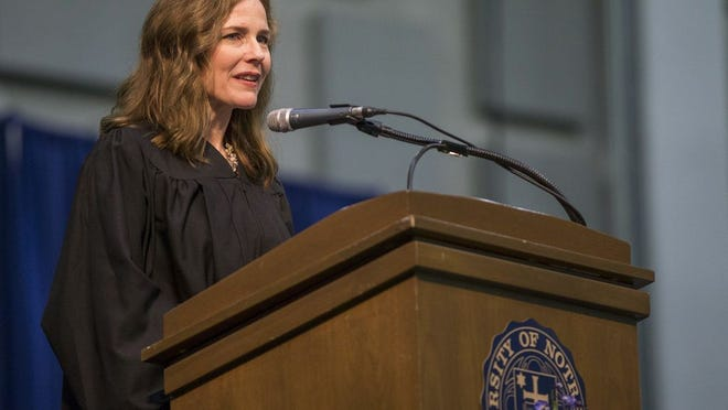 In this May 19, 2018, photo, Amy Coney Barrett, United States Court of Appeals for the Seventh Circuit judge, speaks during the University of Notre Dame's Law School commencement ceremony at the university, in South Bend, Ind. Barrett, a front-runner to fill the Supreme Court seat vacated by the death of Justice Ruth Bader Ginsburg, has established herself as a reliable conservative on hot-button legal issues from abortion to gun control.