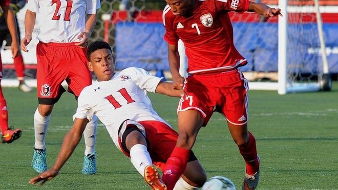 """Durfee and New Bedford boys soccer teams battle it out in this file photo. Durfee will compete in a regional """"pod"""" of schools that includes New Bedford, Dartmouth and Bridgewater-Raynham."""