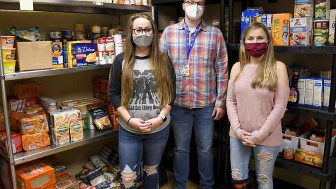 Pictured left to right is Ronni Denham, Steven Morgan and Jessica Fox.