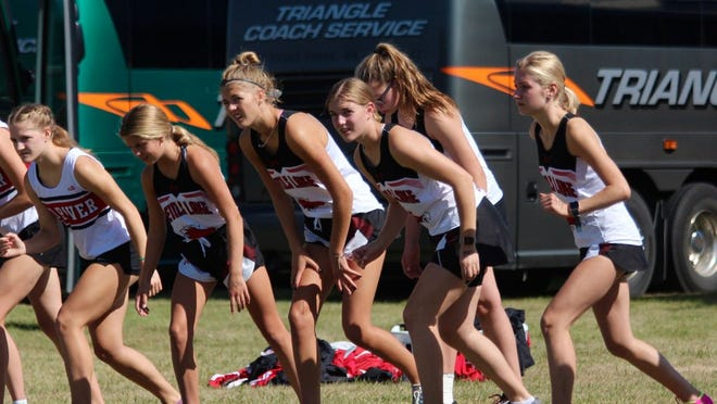 Devils Lake girls cross country runners line up before their race at the Grahams Island Invite on Sept. 12.