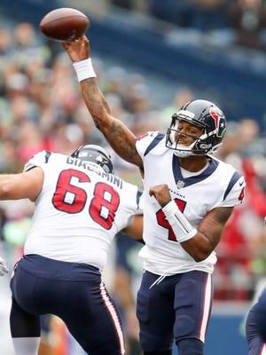 Houston Texans quarterback Deshaun Watson (4) passes against the Seattle Seahawks during the first quarter at CenturyLink Field.