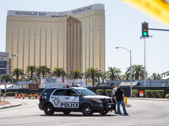 Police still man a roadblack across from the Mandalay Bay resort on Las Vegas Blvd, Wednesday, October 4, 2017.  A mass shooting killed 58 people on Sunday night at a country music festival.