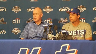 Sandy Alderson (L.) and Jason Vargas (R).