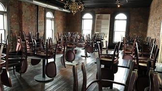 A vintage chandelier and an original wood floor decorate the second-floor dining room of the 1800s-era building where Fat Dan's Deli owner Dan Jarman plans Geraldine's Supper Club & Lounge, opening in Indianapolis' Fletcher Place neighborhood in spring 2018.