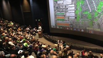 About 150 people attend a presentation of a plan for parking improvements at the Memphis Zoo.