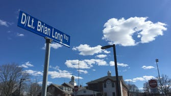 The driveway to the New Milford police station, which opened Saturday, was named after Det. Lt. Brian Long, a borough officer who died of cancer.
