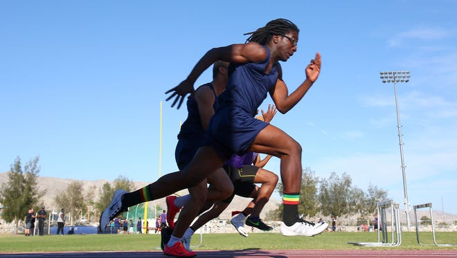 Ras Johnson runs the 100 meter at Desert Hot Springs High School, April 13, 2016. He finished second in his race.