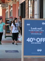 Coconut Point Mall opened at 9am so shoppers were just getting started with their Friday shopping. Alexandra Polk, 13 of Fort Myers, and her sister Emily Polk, 11, window shop as they walk the mall with their parents.