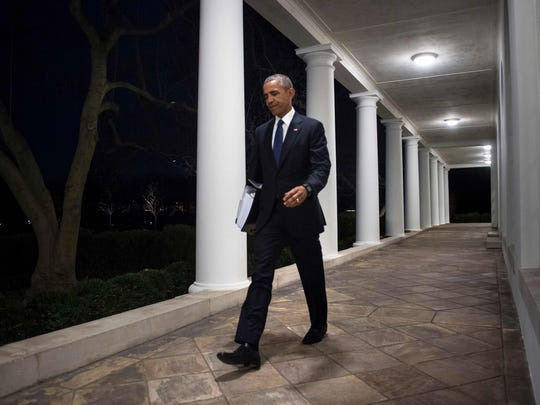 President Obama walks from the West Wing to the residence