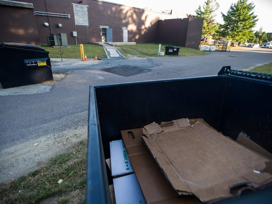 A recycling dumpster behind the Lucky Buffet in Milton holds cardboard from the restaurant Tuesday night, Sept. 12, 2016.