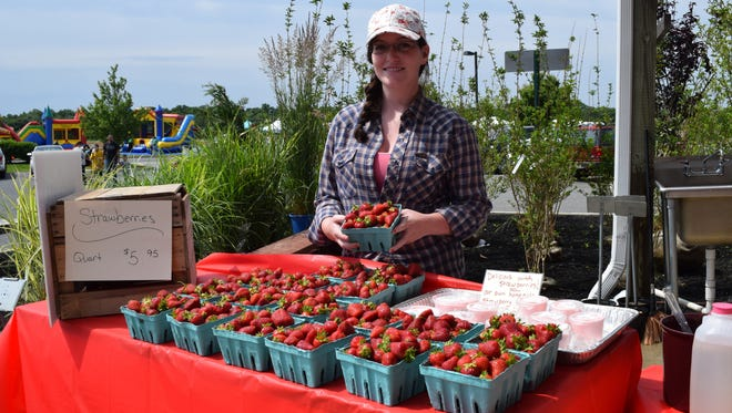 Macy Elwell of Marlboro Farm Market sold fresh strawberries, strawberry smoothies and fruit dip at the Strawberry Festival.