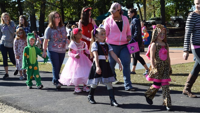 Children parade around the pond at Corson Park during the costume contest at Pumpkin Extravaganza on Saturday, Oct. 21.