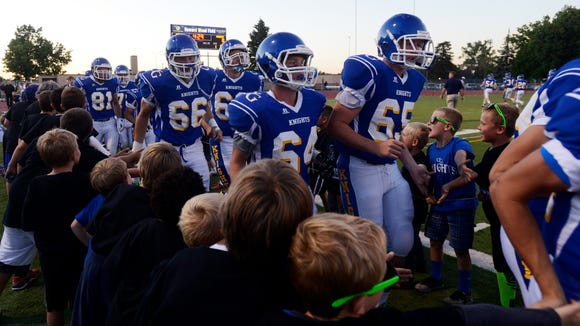 The O'Gorman Knights take to the field to play Lincoln in this year's Dakota Bowl game at Howard Wood Field.